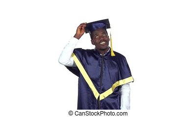 Student picks up square academic cap and throws. Slow...