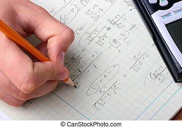 Student - The student is occupied by a mathematical problem.