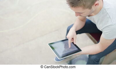Student playing with device