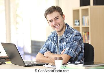 Student posing and looking at camera