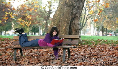 student reading on bench