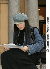 Student reading papers