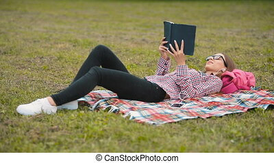 Student Reads Outdoors