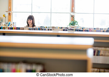 Student Selecting Book In Library