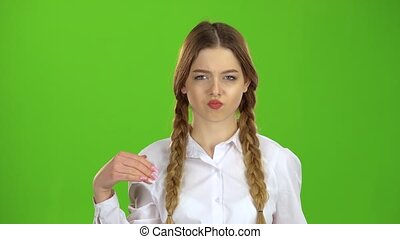 Student shows a fist, she is angry. Green screen - Student...