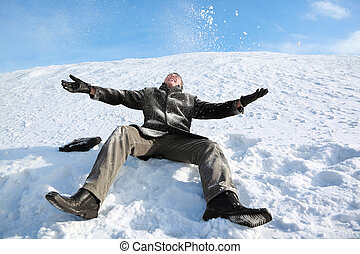 Student sits on snow by winter day and merrily throw him in sky