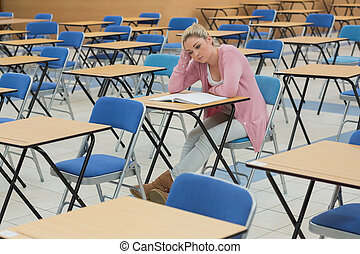 Student sitting at desk thinking
