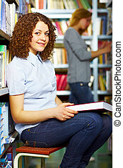Student sitting with book