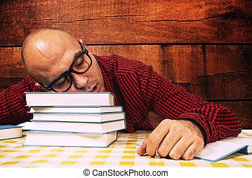Student sleeping on books