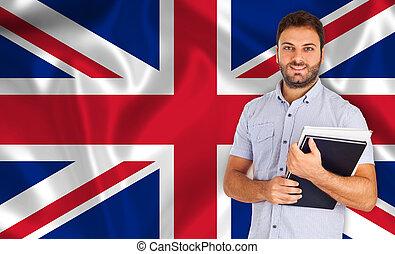 Student smiling over English flag.