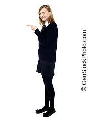 student, stående, från sidan, och, pekande, framfusig