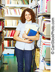 Student standing with books