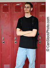 Student stands in front of lockers