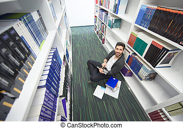 student study in school library - Student reading book in ...