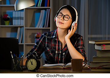 student studying and listening music