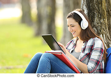 Student studying listening on line lessons - Single student...