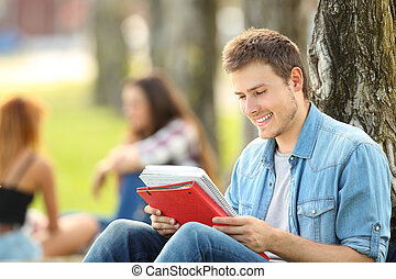 Student studying memorizing notes outdoors