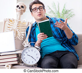 Student studying with skeleton preparing for exams