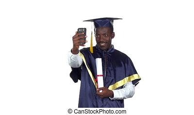 Student takes a photo with a diploma. Slow motion. White