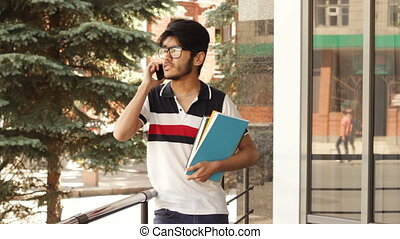 Student talking by cellphone outdoor in summer