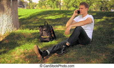 student talking by phone HD video prores - handsome man...
