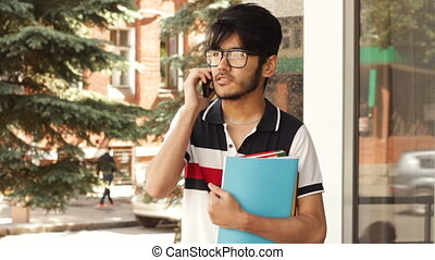 Student talking by smartphone