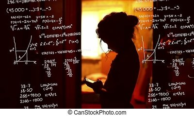 Student teenager girl studying in the phone mathematical...
