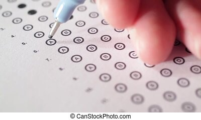Man complete the questionnaire (filling the test form) - school exam concept and another test completing (new job interview, IQ test etc.).