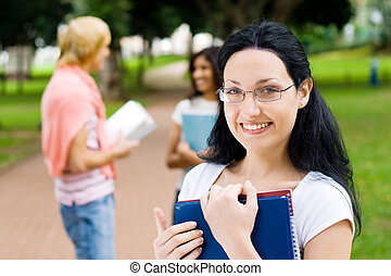 student waiting for friends behind her