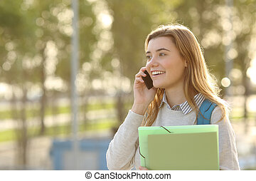 Student walking and calling on phone