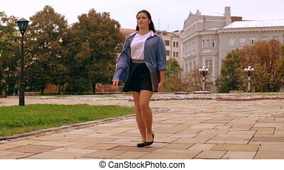 student walks in city autumn season