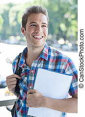 Student wearing backpack - Young male wearing backpack and...