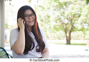 Student wearing glasses. talking on the phone