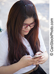 Student wearing glasses that are using smart phones.