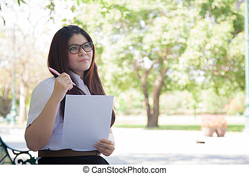 Student wearing glasses that hold documents