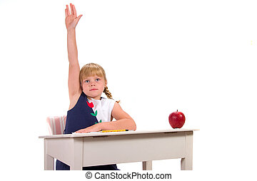 Young female student with hand raised for answer or question sitting at desk with apple