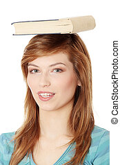 Student with book on her head