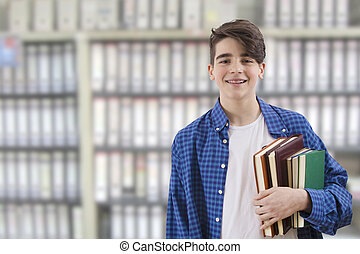 student with books in the library