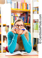 Student with books learning in library