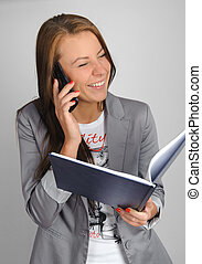 Student with phone and book