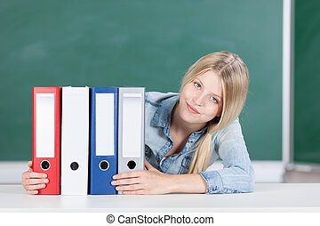 Student with set of files - Pretty young blond female...