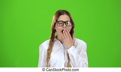 Student with spectacles yawns. Green screen. Slow motion - ...