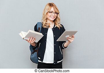 Student with tablet and book