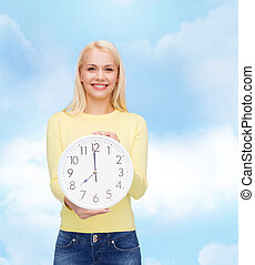 student with wall clock - time, education and people concept...