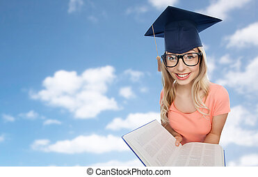 student woman in mortarboard with encyclopedia