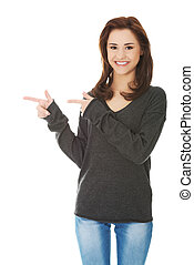 Student woman showing copyspace