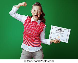 student woman with Certificate of Graduation showing biceps