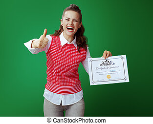 student woman with Certificate of Graduation showing thumbs up