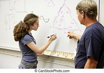 Student Working Equation - A female student working out a...
