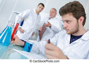 student working with liquids in a lab